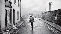 anonymous schoolboy walking the bombed-out streets of Derry.