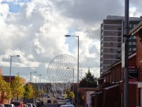 A Belfast street with the RISE sculpture in the background